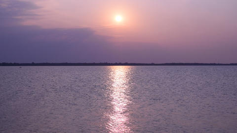 Sunrise over lake or river with sun path Footage