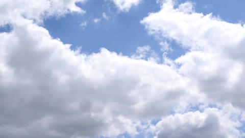 White and grey cumulus clouds on background of blue sky Footage