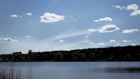 Beautiful clouds moving over lake or river Footage