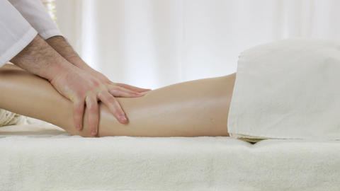 A young girl masseuse at a massage parlor, a relaxing foot massage Footage