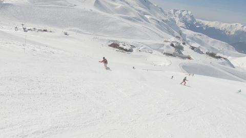 Snowboarder perform tricks Archivo