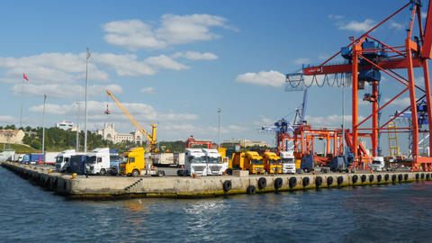 Trucks lined up at shipping facility, seaport, docks or commercial warehouse Footage
