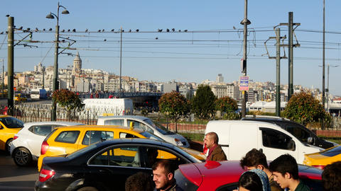 Panaromic steadicam shot at the city center with pedestrians and traffic chaos. Footage