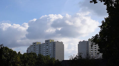 Time lapse of clouds bubbling and boiling over apartment blocks Footage