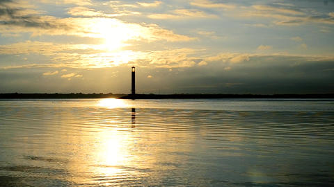 Water landscape at dawn in the morning with lighthouse Footage