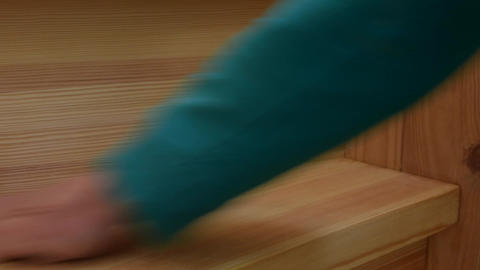 Polishing wooden steps of staircase boards with sandpaper Footage