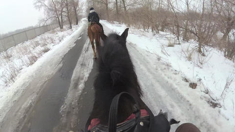 Riding a horse in winter. First person view, top view Footage