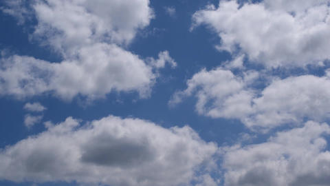 White and grey clouds move in blue sky Footage