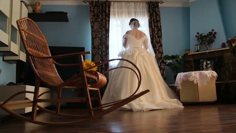 The beautiful bride goes to the window Footage