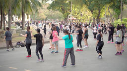 BANGKOK, THAILAND - CIRCA March 2017: Aerobics in Lumpini park. People doing Footage