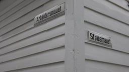 Norway Skuteviken Bergen two street signs at a wooden white house corner Footage