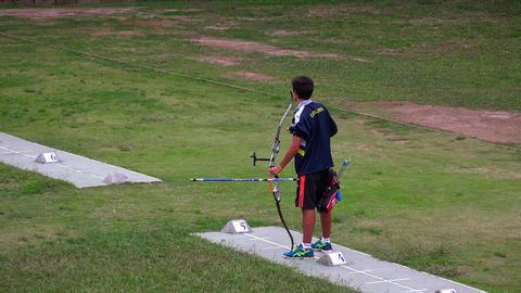 Athlete archer shoots an arrow. 4K Footage