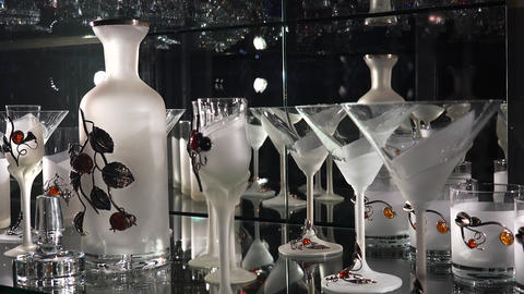 Matt wine glasses on a glass showcase. 4K Footage