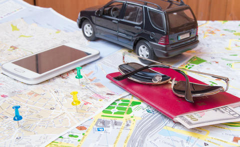 Plan your journey by car, a passport, money, cards, phone, sunglasses Photo