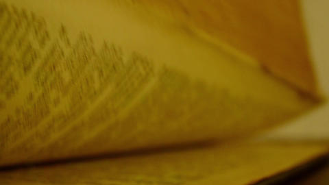Leaf through the pages of an old and thick book Footage