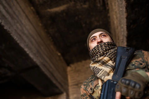 The Arab soldier with the AK-47 Kalashnikov assault rifle Photo