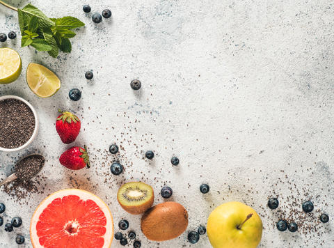 Fresh fruits, berries, chia seeds and mint, copy space Photo