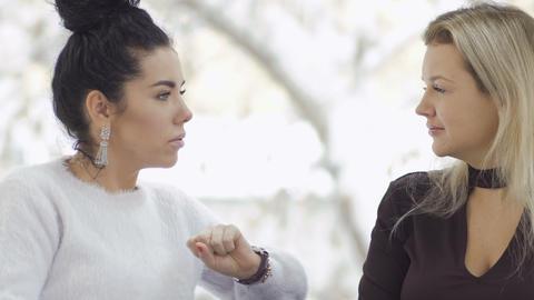 Two pretty businesswomen has a conversation Footage