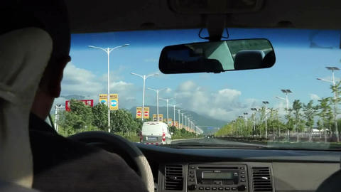 Man driving with yulong glacier in sight Live Action