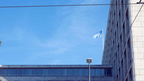 tracking shot on the facade, with the flag of the Fao waving in the blue sky Footage