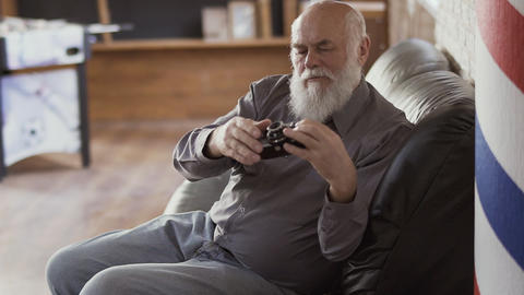 Mature man photographs something with an old camera Footage