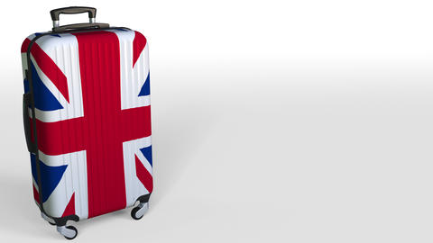 Traveler's suitcase featuring flag of Great Britain. British tourism conceptual Live Action