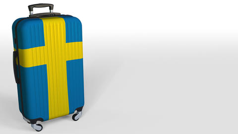 Traveler's suitcase featuring flag of Sweden. Swedish tourism conceptual Footage