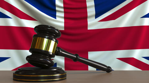 Judge's gavel and block against the flag of Great Britain. British court Live Action