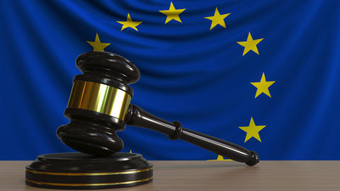 Judge's gavel and block against the flag of the European Union. Court conceptual Live Action