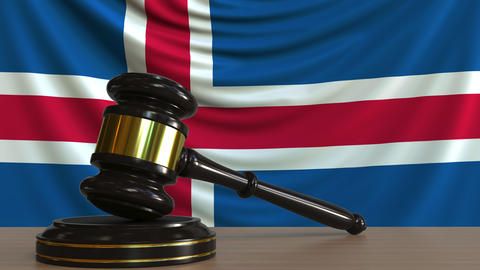 Judge's gavel and block against the flag of Iceland. Icelandic court conceptual Footage
