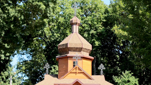 The domes of an ancient wooden Orthodox church. Cross at the top Footage
