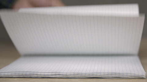 Browsing empty pages of copybook, selective focus ライブ動画