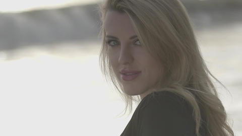 Beautiful blonde girl enjoys the beach lifestyle Footage