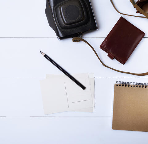 empty paper postcards and a black wooden pencil on a white woode Photo
