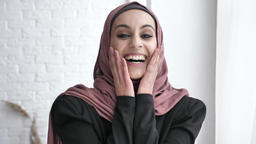 Young Indian girl in hijab smiling, laughing, surprised, sunlight, near the Footage