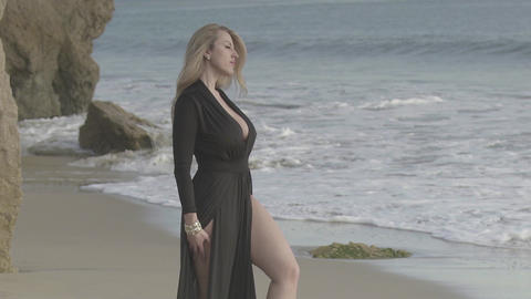 sexy blonde with bare feet on the beach Live Action
