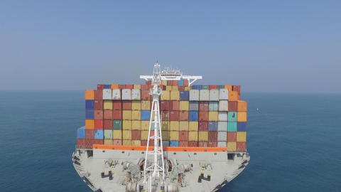 aerial photography of a cargo ship with containers on board in the sea Footage