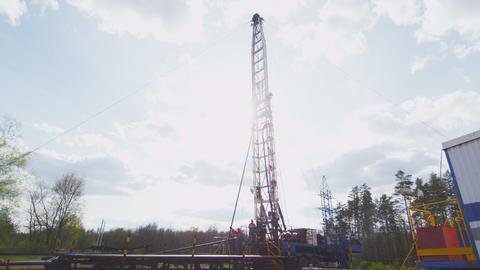 Oil Plant Staff Works with Mechanism Lowering Hook ビデオ
