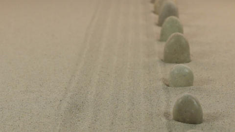 Approximation of white stones standing on lines from sand. Dolly Footage