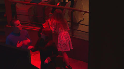 Two girls smile and dance in a nightclub Footage