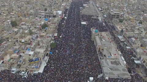 a suburb of Baghdad Sadr City, a large crowd of people, the moslem of Muslims, Footage