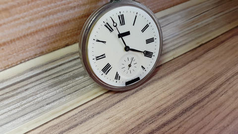 Pocket Watch On The Background Of A Wooden Wall Footage