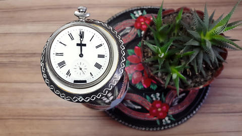 Clock In Flower Against The Background Of A Wooden Wall Archivo