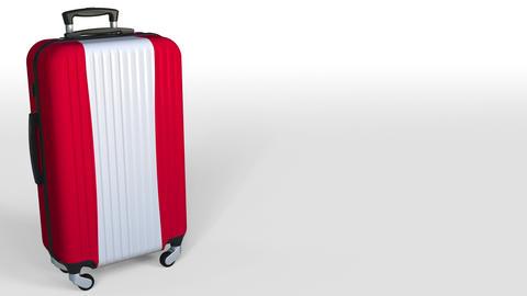 Traveler's suitcase featuring flag of Austria. Austrian tourism conceptual Archivo
