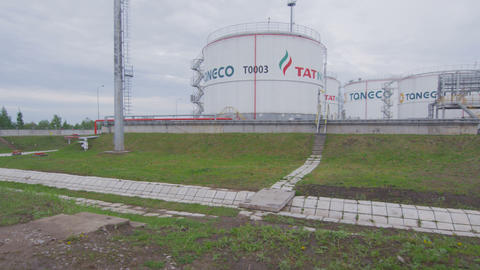 Round Tatneft Logo Reservoirs among Green Lawns Image