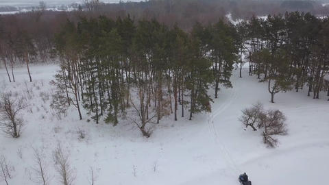 View from the height of ATVs riding through the snowy landscape in winter Archivo
