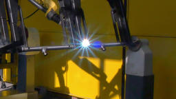 Metal iron laser argon welding on industrial CNC machine in factory Footage