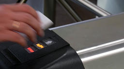 Hands of people apply electronic pass to turnstile wicket checkpoint in office Archivo