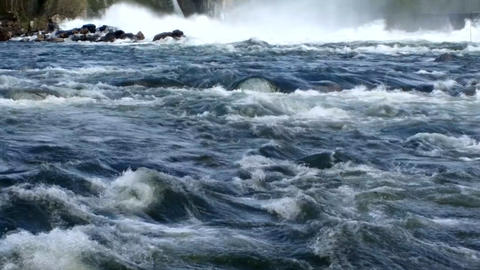 powerful stream of water falls through open gate hydroelectric power plants Footage