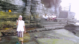 Clergymen of Tanah Lot Temple rest,Bali Footage